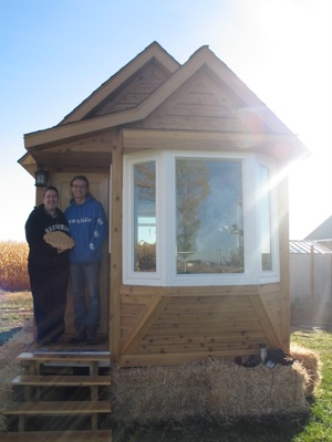 Jewels Hall-Payne (L) and Molly Hall-Payne (R) stand next to their tiny home in Eaton. Photo: Susan Glairon.