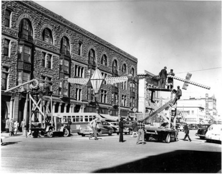 """(""""Christmas Decorations on Tejon Street,"""" by George Wesley Murray, ca. 1951-1955. Courtesy of Special Collections, Pikes Peak Library District. Image Number: 001-4696.)"""