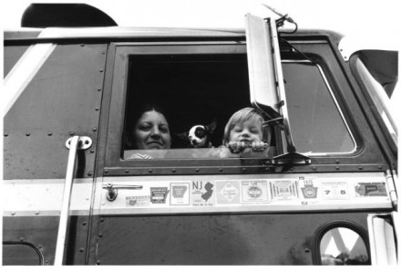 "(""Family with Trucker I-25,"" by Myron Wood, August 1978. Copyright Pikes Peak Library District, courtesy of Special Collections. Image Number: 002-3084.)"