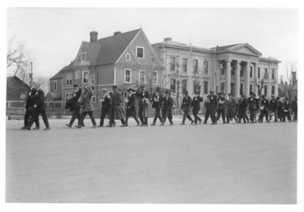 "(""Parade Past City Hall,"" by Photo Craft Shop, date unknown. Courtesy of Special Collections, Pikes Peak Library District. Image Number: 102-2486.)"