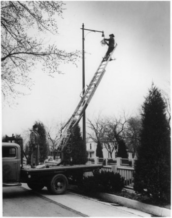 """Fixing a Lamppost,"" by George Wesley Murray, 1945. Courtesy of Special Collections, Pikes Peak Library District. Image Number: 001-5649"