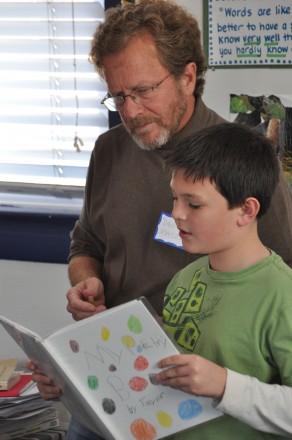 Tayler Knight reads a poem to Colorado Poet Laureate David Mason