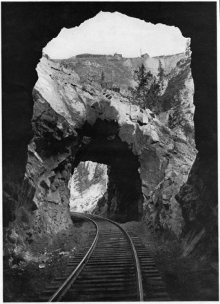 """Double Tunnel, Cañon of the Eagle River, Colorado"" by George L. Beam, 1922. Courtesy of Special Collections, Pikes Peak Library District. Image Number: 257-6497."