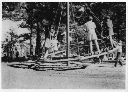 """Children on Merry-Go-Round"" by Harry L. Standley, date unknown. Courtesy of Special Collections, Pikes Peak Library District. Image Number: 102-2240."