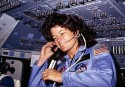 [Sally Ride] America&#039;s first woman astronaut communitcates with ground controllers from the flight deck during the six day mission of the Challenger. National Aeronautics and Space Administration., 06/18/1983 - 06/24/1983. Courtesy: National Archives.