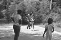 Children playing jump rope in the Children&#039;s Folklore Area at the 1985 Florida Folk Festival - White Springs, Florida, State Archives of Florida, Floriday Memory, http://floridamemory.com/items/show/110365.