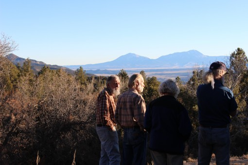 Jack Yule, Jim McCain, Roz McCain, and Jeff Briggs look south from the McCains' property, toward Shell's Freeman well, where preliminary drilling took place in November of 2012.