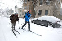 Andre Tranchemantague (left) and Will Guerette ski to a bar during the early stages of the snowstorm Friday in Portland, Maine. The storm sweeping into Maine already has dumped half a foot of snow around Portland, and contributed to a 19-car pileup.
