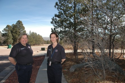 Christina Randall and Amy Sylvester of the Colorado Springs Fire Department Wildland Fire Mitigation Unit in one of the treatment areas in the WUI. Photo: Andrea Chalfin/KRCC