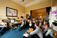 Listeners gather in the Oslo Grand Hotel's Nobel Suite for a Havresekken performance.